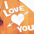 Text I Love You and a heart pierced by an arrow — Stock Photo #66470765