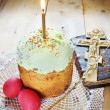 Classical Orthodox Christian Easter still life with red eggs and burning candle over the cake — Stock Photo #70053757