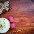 Composition about Orthodox Christian Easter with red eggs and burning candle over the cake — Stock Photo #70054095