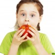 Little cute girl bites a big red apple with appetite — Stock Photo #71563863