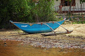 Poor fishermans outrigger canoe — Stock Photo