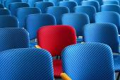 Red seat standing out — Stock Photo