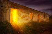 Mysterious light in abandoned house — Stock Photo