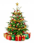Gorgeous Christmas tree with gift boxes — Stock Photo