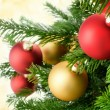 Christmas baubles on lush fir branches — Stock Photo #58802543