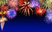 Fireworks display on dark blue — Stock Photo
