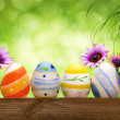 Easter eggs, flowers and bokeh background — Stock Photo #67371501