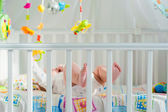 Baby playing in a crib — Stock Photo