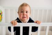 Baby crying in the crib — Stock Photo