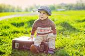 Small child on a suitcase — Stock Photo