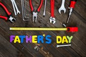 Letters and tools wooden background fathers day — Stock Photo