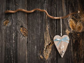 Wooden heart hanging on a branch — Stock Photo