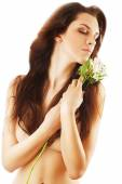 Sensual healthy woman with white flower — Стоковое фото
