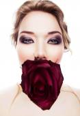 Funny woman with rose in mouth — Stock Photo