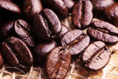 Coffee beans on drapery — Stock Photo