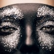 Woman in black paint and glitter — Stock Photo #55901047