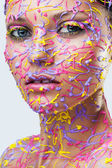 Woman in vibrant paint — Stock Photo