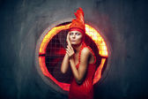 Female in red dress and hat — Stock Photo