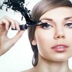 Woman with mascara brush — Stock Photo #64621179