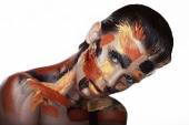 Woman with paint on face — Stock Photo
