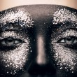 Woman in black paint and glitter — Stock Photo #65325839
