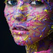 Woman in colourful paint — Stock Photo #65329609