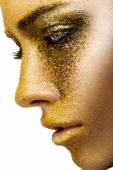 Woman with a golden make-up — Stock Photo