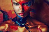 Portrait of girl in paints — Stockfoto