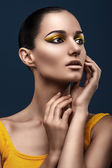 Girl with make-up yellow — Stock Photo