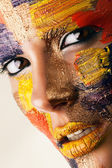 Portrait of woman in paint — Stock Photo