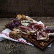 Meat selection, nuts and honey — Stock Photo #65986981
