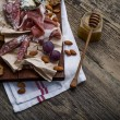 Meat selection, nuts and honey — Stock Photo #65987145