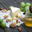 Cheese with grapes, honey and nuts — Stock Photo #66054055