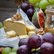 Cheese with grapes, honey and nuts — Stock Photo #66054149