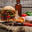 Hamburger with fried potato, beer and sauce — Stock Photo #73938853
