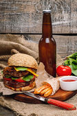 Hamburger with fried potato, beer and sauce — Stock Photo