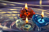 Colorful three candles floating on water aroma bowl,retro — Stock Photo