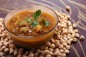 Indian spicy chana masala with raw chickpeas — Zdjęcie stockowe