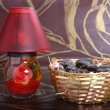 Home made chocolates in metal bowl with decorated lamp — Stock Photo #67146841