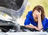 Girl with a broken car — Stock Photo