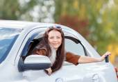 Girl in a car holding keys — Stock Photo