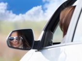 Young girl in a car — Stock Photo