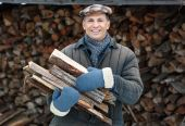 Man  Carrying Firewood — Stock Photo