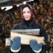 Woman in ethnic costume with firewood — Foto Stock #60770197
