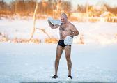 Man wipes towel after swimming in  freezing — Zdjęcie stockowe