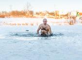 Winter swimming. Man in  ice-hole — Foto de Stock