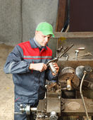 Turner works for lathe — Stock Photo