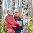 Family in the forest collecting birch sap — Stock Photo #70199731