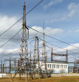 Electricity pylons and power plant — Stock Photo