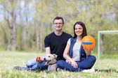 Happy young couple and  dog — Fotografia Stock